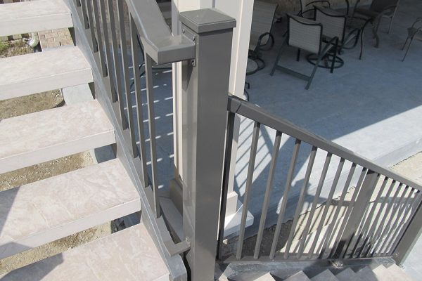 Custom Picket Stair Rail connection in Rideau Brown